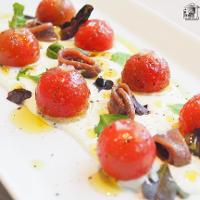 Tomatitos con crema de queso y anchoas